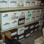"Artifact storage iising Banker Boxes n the Fan Room. ""Like with like"" i.e. webbing together, shoes together etc."