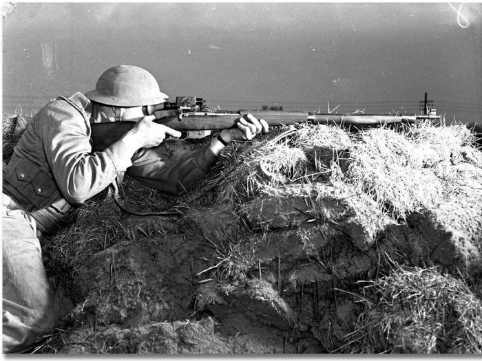 Soldier aiming a telescopically equipped rifle. (Photo credit: Archives of Ontario)