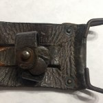 Belt hook and snap of knife scabbard.