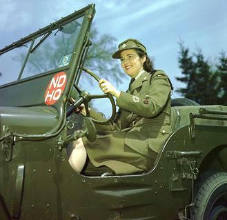 CWAC driving a Canadian Contract Willys W-LU 400-M-PERS-1  car 5 Cwt (jeep) in National Defence Headquarters markings (NDHQ)  markings, Ottawa area circa 1942-1945