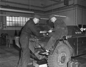 Mechanics at work on Ferret 54-82620 (EF60-9205-1 CFJIC CD No 1 )