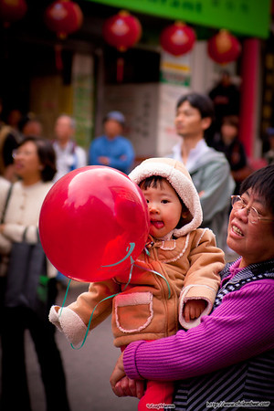 child and red balloon