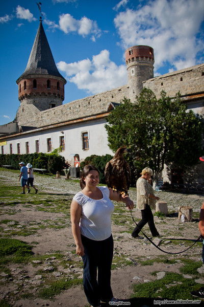 Iryna with golden eagle at medieval fortress
