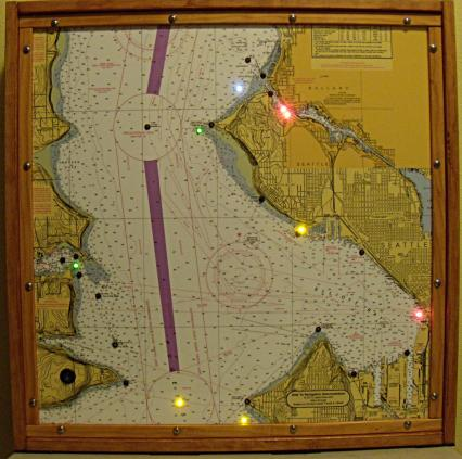 Aids to Navigation demonstration chart of Elliot Bay and Seattle, the Aids to Navigation are demonstrated using flashing LED's. The lights flash with the same characteristic as the lights on the water.