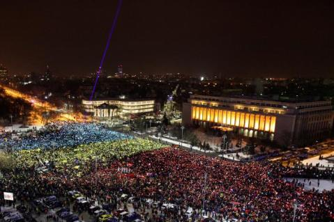 People used their mobile phones to shine the Romanian flag