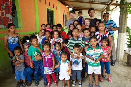 Derrick, Marshalll and Tessa are standing beside Pastor Damiàn, along with many children in the community that come to his home for food.Derrick, Marshalll and Tessa are standing beside Pastor Damiàn, along with many children in the community that come to his home for food.