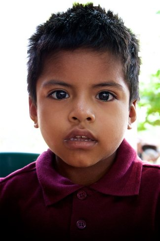 This is Bernato, he, along with many other children in the community gather at pastor Damián's house for food every day.