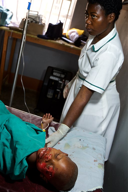 School nurse Namulinde Rebecca administering care to Catherine