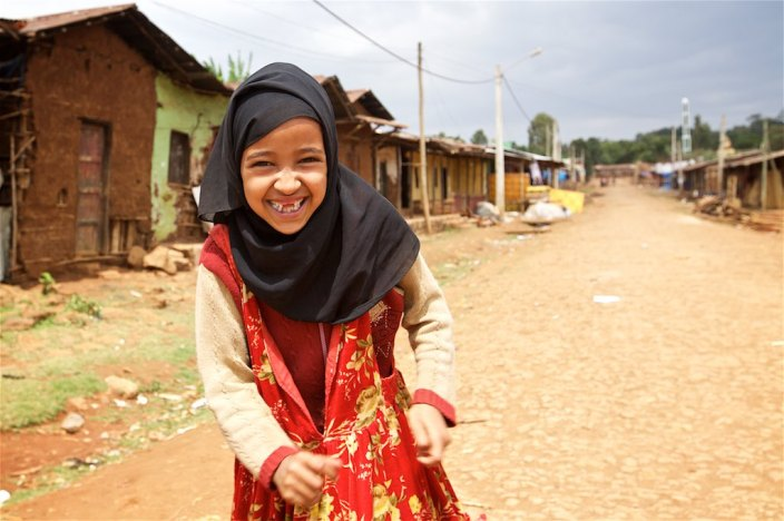 Precious girl on the streets of Gunchire village... two missing teeth makes her little smile all the more precious :)