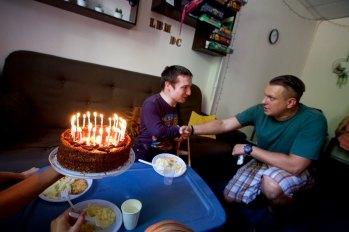 Tolik's birthday party, Pastor Andrew shaking Tolik's hand