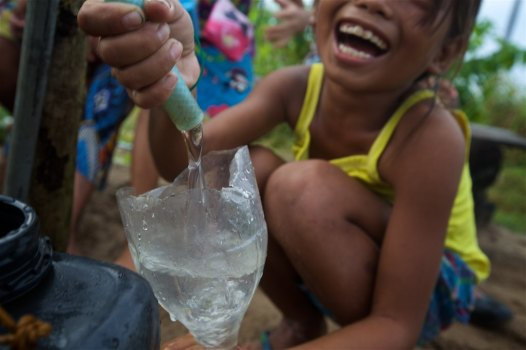 Watching Badjao children celebrate the arrival of clean water to their village by the sea in the Philippines