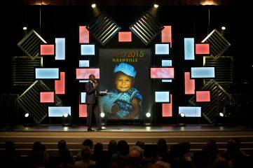 Photoraphs on stage at CAFO Summit