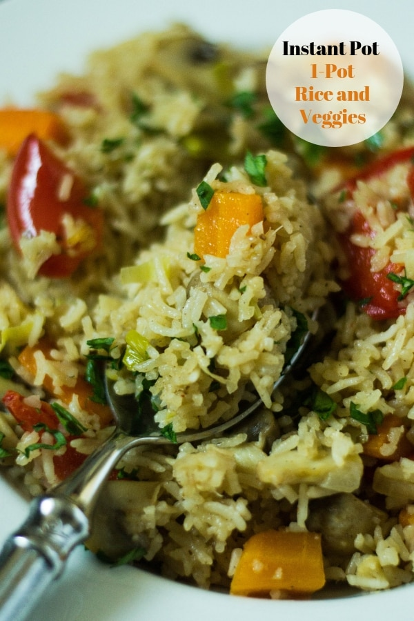 Instant Pot Rice and vegetables with a spoon