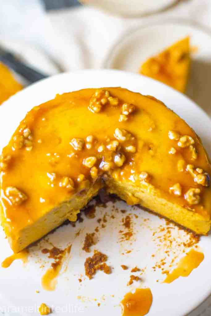 Instant Pot Pumpkin Cheesecake on a cake stand
