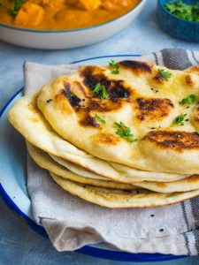 Naan bread stacked on top each other