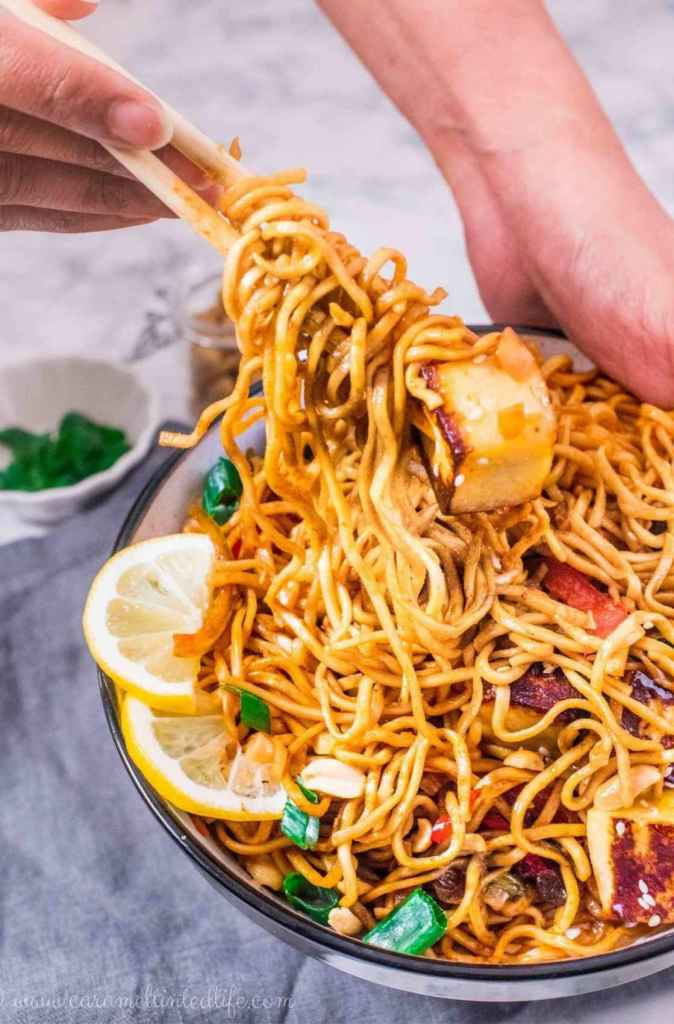 Noodle bowl being served with chopsticks