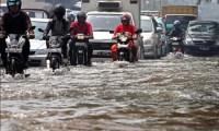 Tips Terobos Banjir Menggunakan Sepeda Motor