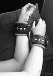 wearing rimba wide leather wrist cuffs cara sutra-1 sleeping in bondage
