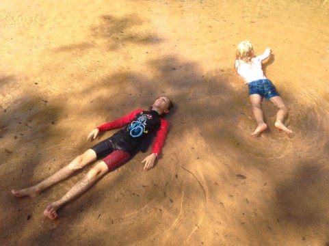 "The kids lying in the ""just right"" water of Douglas Hot Springs."