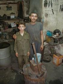 Smith and son in suq near Bab al-Hadid