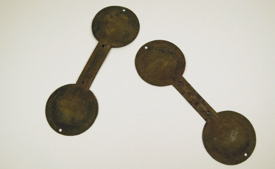 Cymbals (qraqeb), Algeria, early/mid-20th century. Iron. Logan Museum of Anthropology, Beloit College, Beloit, WI, 2803.1ab The double-headed iron cymbals called qraqeb are usually the first instruments that a Gnawa musician learns to play. A pair of cymbals is held in one hand and tapped together, making a loud clacking noise. A musician usually plays two pairs at once. For Gnawa musicians, who identify as descendants of slaves, the music evokes strongly felt associations with West Africa. Musicians claim that the repetitive sound of the cymbals imitates the sound made by chains used to shackle the enslaved. The music provides a means to tell a very personal history.