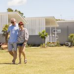 Couple outside Caravan Park Cabin