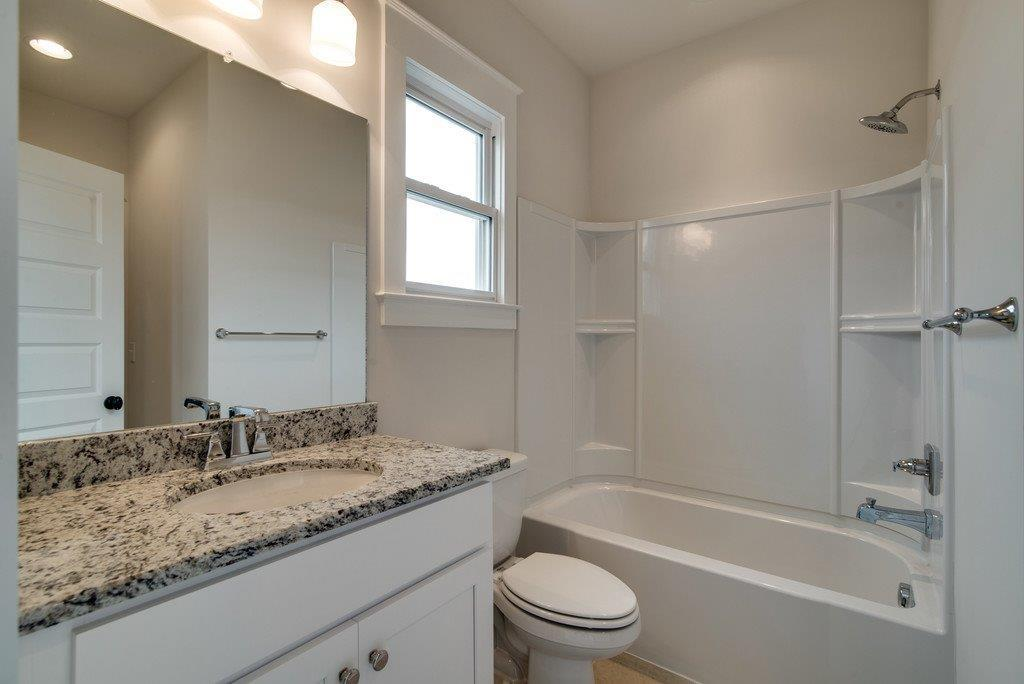 New Home Custom half Bathroom in Tollgate Village by Carbine & Associates