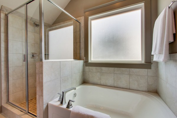 New Home Custom Master Bathroom in Tollgate Village by Carbine & Associates