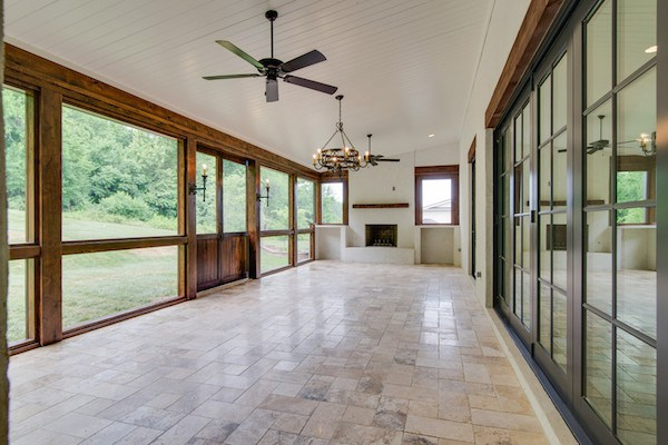 Accordian Doors Lead To Covered Porch With Sliding Barn Wood Doors, Carbine & Assoc.