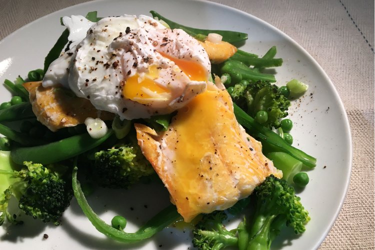 Delicious carb-free dinner - smoked haddock with poached egg and steamed greens