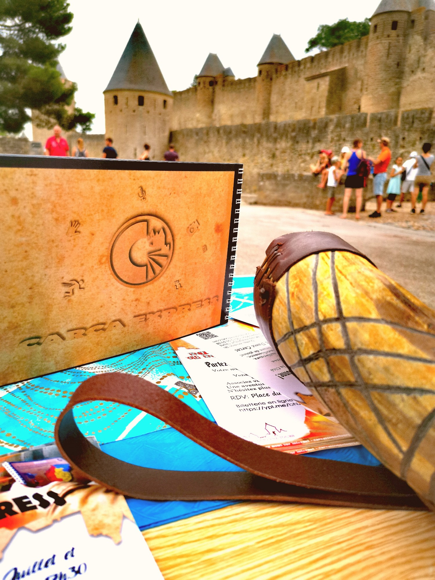 carca express notebook in front of the medieval city of Carcassonne