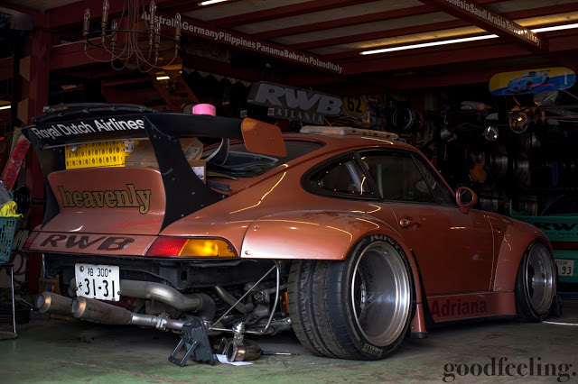 "RWB Porsche 993 nicknamed ""Adriana"" rear 3/4 view with rear bumper removed exposing exhaust and turbo system components"