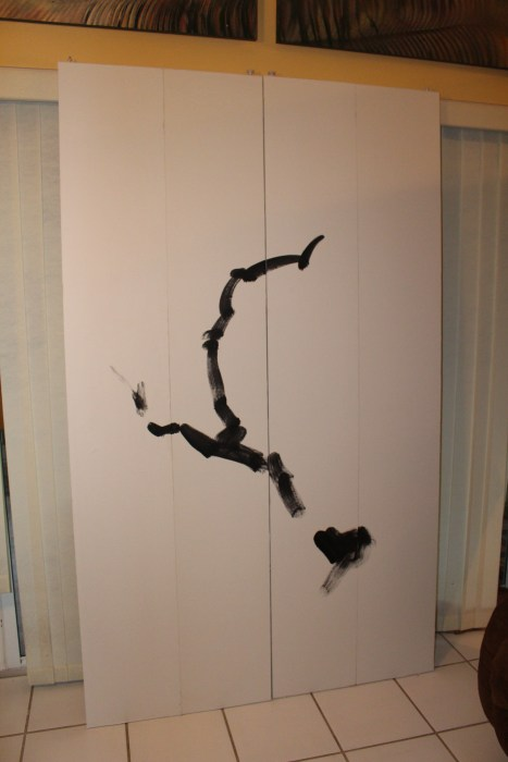 """My son likes all things Japanese. So I converted his closet doors into a Sumi painting. I covered the doors with flat panels, then covered them with """"rice"""" paper. Trunk first, then branches."""