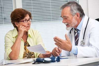 m_bigstock-Doctor-Talking-To-His-Female-P-48071645
