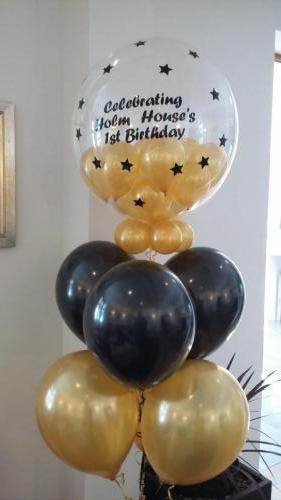 Bouquet Of 6 Latex With Co-ordinating gumball topper for Holm House Hotel By Cardiff Balloons