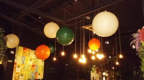 Giant 3' Balloons hanging from the ceiling at Treetops Adventure Golf