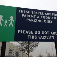 A message for people who misuse parent and child parking spaces