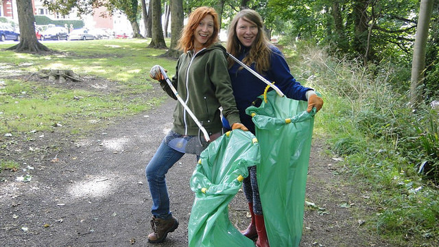 Two volunteers litterpicking at Penylan