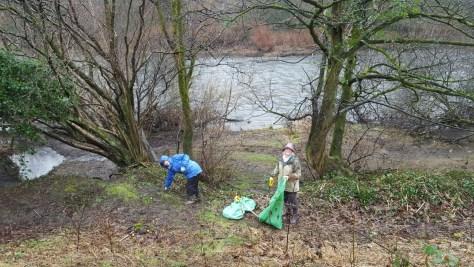 volunteers on the riverbank