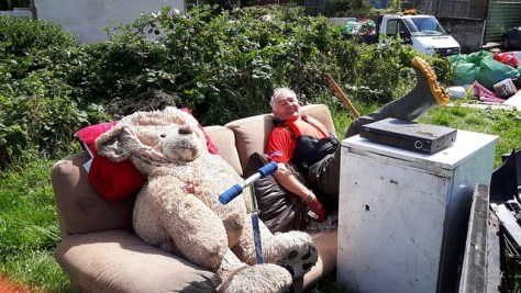 Various items of household rubbish including a giant teddy bear