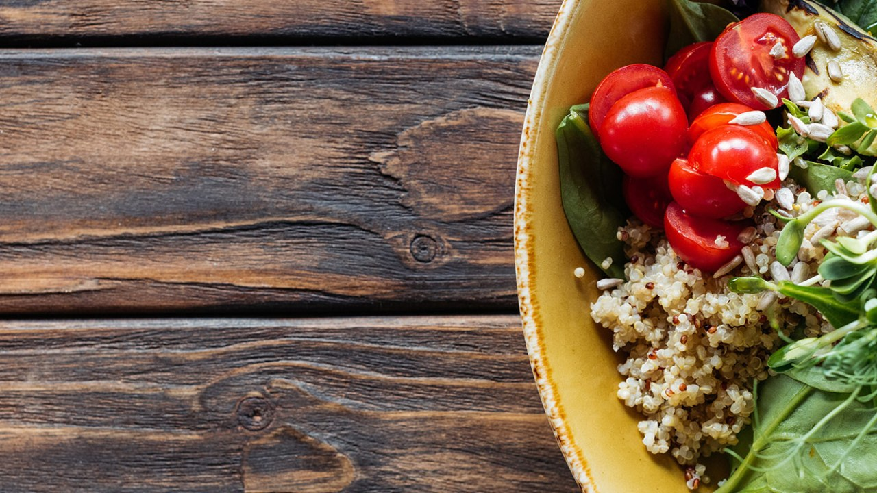 table with salad and grains, signifying healthy weight loss and wellness coaching