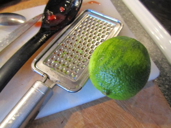Grate the lemon and lime skin. Add this to the berry mixture after you've boiled the berries & spices.