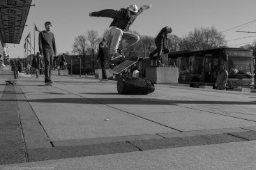 Skateboarding outside Oslo City Hall. Kick flip over a garbage bin.