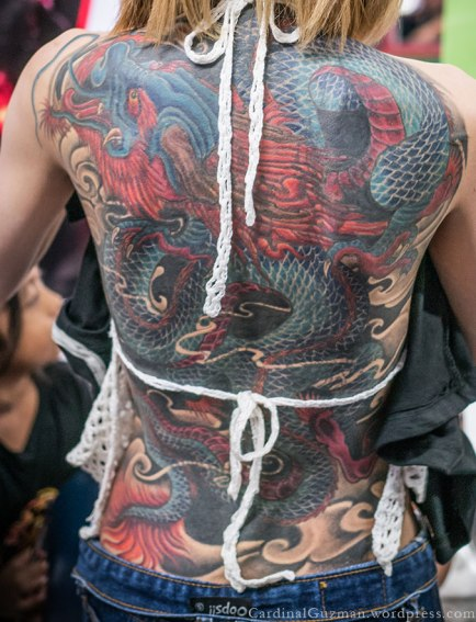 A full back piece with a Japanese dragon. Tattoo by Peerapong Bank Tattoo, Bangkok, Thailand.