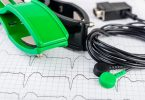 ECG electrodes, cable and acute myocardial infarction record.  Medical background.