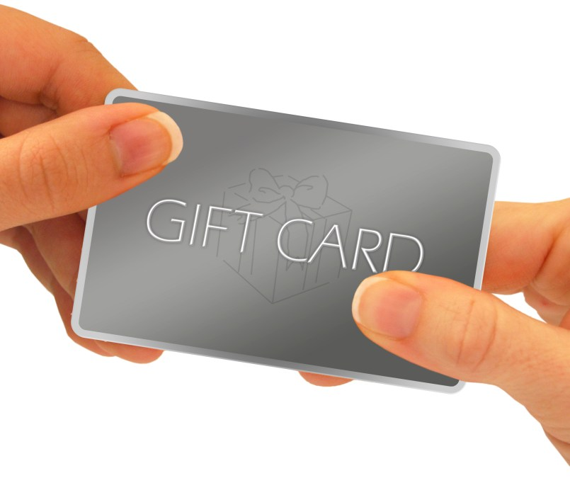 A gift card being exchanged through hands - isolated over a white background. Clipping path is included.