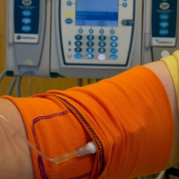 The CareAline PICC Sleeve has a One of a Kind button hole that is used to feed the lines through the sleeve, keeping lines off of your Skin - Skin can harbor bacteria. Also this prevents from lines being pressed into your arm, making things a bit more comfortable.