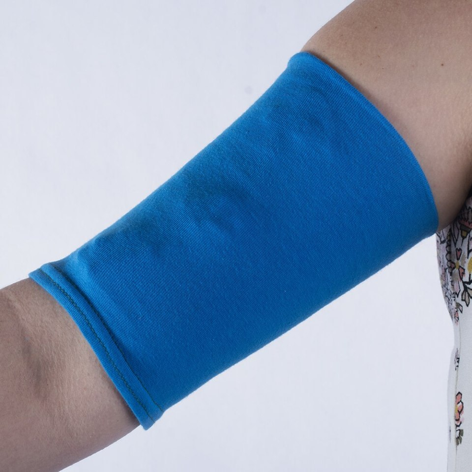 Fold the top fabric of your CareAline PICC sleeve down to cover your lines.