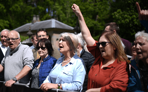 Abuse protesters gather at venue where Karen Bradley hosted at Royal garden party
