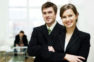 picture of young man and woman in professional business atire